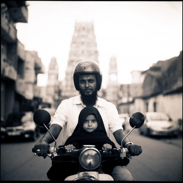 Father and daughter on moped in the streets of Colombo, Sri Lanka.